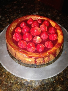 Yum, cheesecake with strawberries and a raspberry glaze.